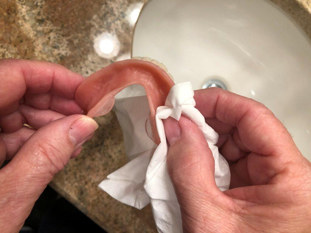 dry denture for sore spot indicator